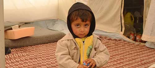 Syrian child in tent