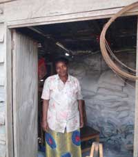 Valentine outside her home in the Goma refugee camp